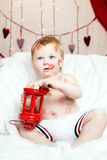 Kid covered in kisses Royalty Free Stock Photo