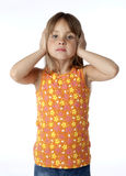 Kid Covering Ears Royalty Free Stock Image
