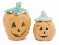 Kid-Crafted Clay Jack-o-Lanterns. Clay Jack-o-lanterns made and painted by children stock photo