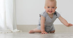 Kid crawls to camera smiles and can see four teeth stock video