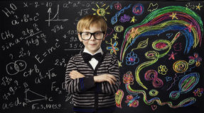 Kid Creativity Education Concept, Child Learning Art Mathematics. Formula, School Boy Ideas on Black Chalk Board stock image