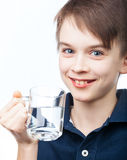 Kid with cup of water Royalty Free Stock Images