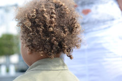 Kid curly hair back 2. Detail on childs back head with nice curly hair stock photos