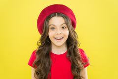 Kid cute face with adorable curly hairstyle wear beret hat. Little fashionista. Perfect curls. Little girl grow long. Hair. Styling of curly hair. Hairdresser stock photo