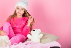 Kid cute girl play with soft toy teddy bear pink background. Unique attachments to stuffed animals. Child small girl. Playful hold teddy bear plush toy. Teddy royalty free stock photography