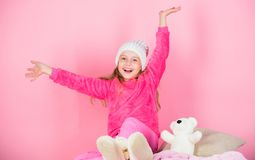 Kid cute girl play with soft toy teddy bear pink background. Unique attachments to stuffed animals. Teddy bears improve. Psychological wellbeing. Child small royalty free stock images