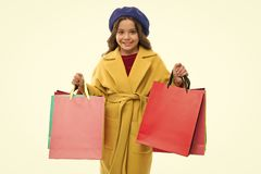 Kid cute little girl hold bunch shopping bags. Child satisfied by shopping isolated white background. Obsessed with. Shopping and clothing malls. Shopaholic stock image
