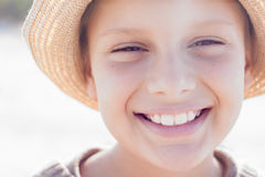 Kid cute straw hat happy smile. Close up Royalty Free Stock Photography
