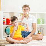 Kid and dad having a phone call with tin cans Royalty Free Stock Image