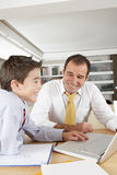 Kid and dad on laptop Royalty Free Stock Photos