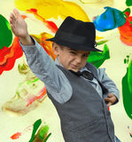 Kid dancing. Child dancing on a painted background Stock Images