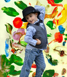 Kid dancing. Child dancing on a painted background Royalty Free Stock Photos