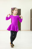 Kid is dancing wearing in dance costume. Kid is dancing. Little girl wearing in a dance costume Stock Photo