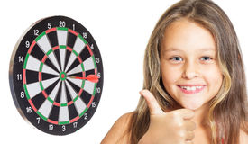 Kid and darts Royalty Free Stock Images