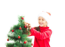Kid decorate the Christmas tree Stock Photos