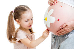 Kid decorating pregnant mother's belly Stock Photography