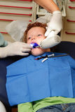 Kid at dentist Stock Images