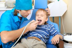 Kid and dentist Royalty Free Stock Images