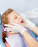 Kid in dentist examination room Stock Photos