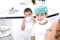 Kid Dentists teeth checkup Royalty Free Stock Image