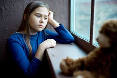 Child abuse at home. Kid is depressed because of child abuse and domestic violence Royalty Free Stock Photography