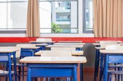 Kid desks in elementary classroom Stock Images