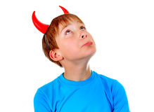 Kid with Devil Horns. Pensive Kid with Devil Horns Isolated on the White Background Royalty Free Stock Images
