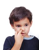 Kid diging his nose. A little cute kid is playing with his nose Stock Images