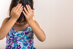 Kid Disappointed Background / Kid Disappointed / Kid Expresses Disappointment. Little girl covers her forehead with hands when feeling disappointed Stock Photo