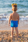 Kid in diving mask on the beach Royalty Free Stock Photos