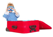 Kid with diving mask sail in suitcase. Kid with diving mask in sailor suit sail in red suitcase. Over  white background Stock Photos