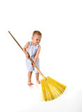 Kid does cleaning Stock Photos