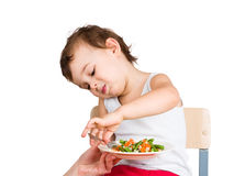 Kid does not want to eat. Isolated on white Stock Image