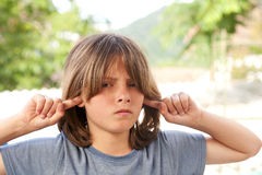 Kid does not want to listen. Displeasure Royalty Free Stock Photo