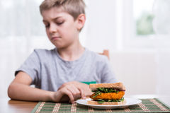 Kid doesn't want healthy sandwich Stock Photography
