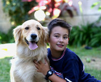 Kid dog. A kid with his Golden Retriever dog Stock Photography
