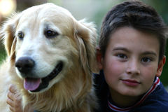 Kid dog. A kid with his Golden Retriever dog Royalty Free Stock Photography