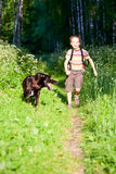 Kid with a dog Royalty Free Stock Images