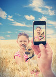 kid with a dog in wheat Stock Photo