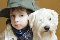 Kid with dog. Young boy with man best friend Royalty Free Stock Photography