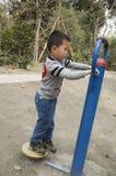 Kid doing exercise Royalty Free Stock Photo