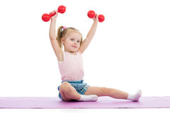 Kid doing exercises with dumbbells Stock Photos
