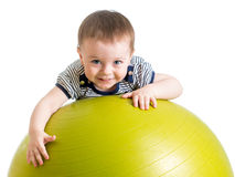 Kid doing fitness exercise on fitness ball royalty free stock images