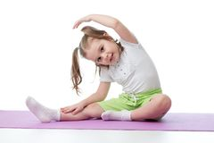 Kid doing fitness exercises Stock Images