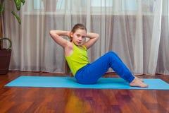 Kid doing fitness exercises Stock Image