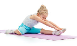 Kid doing fitness exercises Stock Image