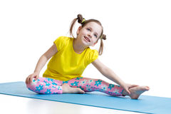 Kid doing fitness exercises Stock Photography
