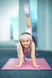Kid doing fitness exercises. Near mirror Royalty Free Stock Photos