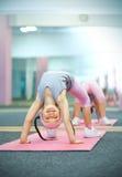 Kid doing fitness exercises. Near mirror Royalty Free Stock Image