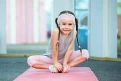 Kid doing fitness exercises. Near mirror Royalty Free Stock Photo